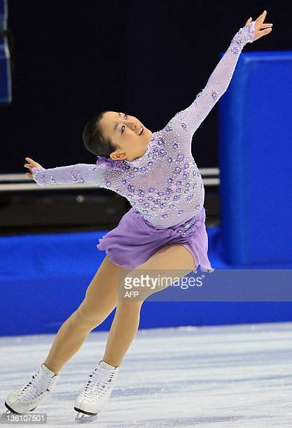 Twotime world champion Mao Asada performs on the ice to win Japan's national championships in Osaka on December 25 2011 Asada pulled out of the Grand...