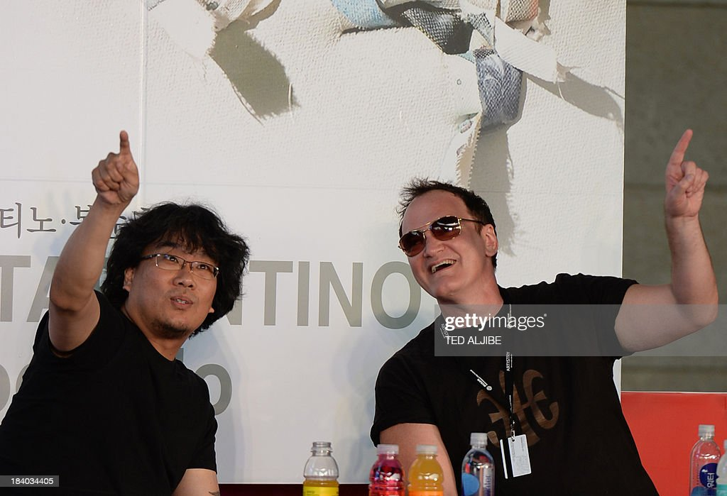 Two-times Oscar awards winner and hollywood director Quentin Tarantino (R) gestures along with South Korean director Bong Joon-Ho during the open talk event at the 18th Busan International Film Festival (BIFF) in Busan on October 11, 2013. The Busan film festival is being held from October 2-12.
