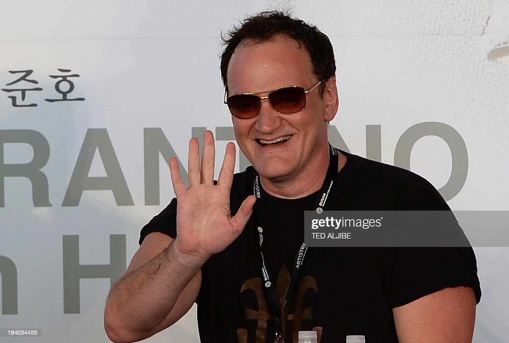 Two-times Oscar awards winner and hollywood director Quentin Tarantino greets fans during the open talk event at the 18th Busan International Film Festival (BIFF) in Busan on October 11, 2013. The Busan film festival is being held from October 2-12.