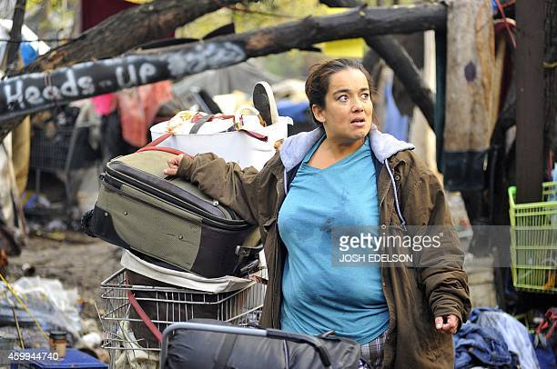 Twoyear resident Yolanda Gutierrez looks on from a Silicon Valley homeless encampment known as The Jungle on December 4 in San Jose California...