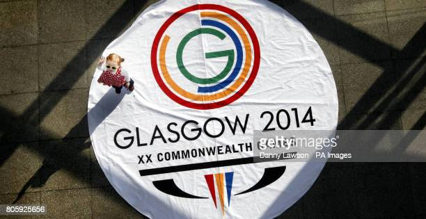 Twoyearold Avia Sloan stands on the new Glasgow 2014 Commonwealth Games logo during its launch at the Clyde Auditorium in Glasgow