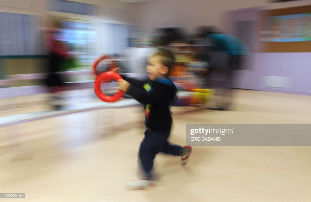 A two-year-old child plays at a kindergarten in Firmi, central southern France, on January 14, 2013. French government is expected to announce in the coming days schooling for toddlers (children less than three years). CAPTION