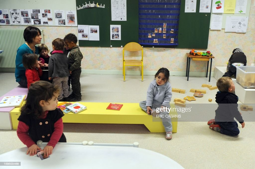 Two-year-old children play at a kindergarten in Firmi, central southern France, on January 14, 2013. French government is expected to announce in the coming days schooling for toddlers (children less than three years).