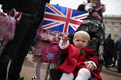 Twoyearold Fleur Burrows waves the Union Jack flag joining thousands of people in front of Buckingham Palace after the announcement of the birth of...