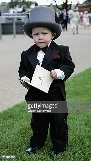 Twoyearold Matthew Gorham arrives at the third day of Royal Ascot at the Ascot Racecourse on June 22 2006 in Berkshire England The event has been one...