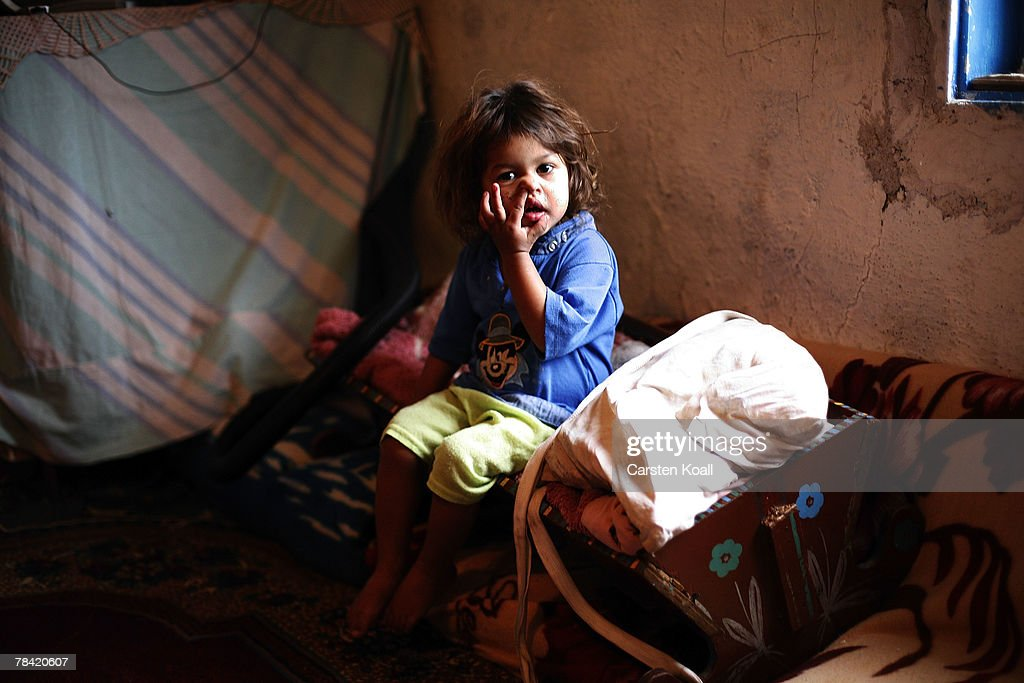 Two-year-old Roma refugee Sevkije sits in her family's house in the Cesmin Lug refugee camp in the Serbian district December 12, 2007 in Kosovo province, Serbia. One hundred and fourty-four refugees live in the camp near toxic metal waste left by the Trepca mines, living in extremely poor conditions with no running water. Members of the Roma minority were forced to flee their homes in the Mahala district in southern Mitrovica during the Kosovo war in the 1999. They settled in the Serb-populated northern side of the divided province. Were independence to come to Kosovo, the north would continue as a Serbian enclave. Kosovo, administered by the United Nations since the 1990 conflict, is home to approximately 120,000 Serbs, who face an uncertain future should the province, with its majority Albanian population, become independent under a U.N. proposed plan.