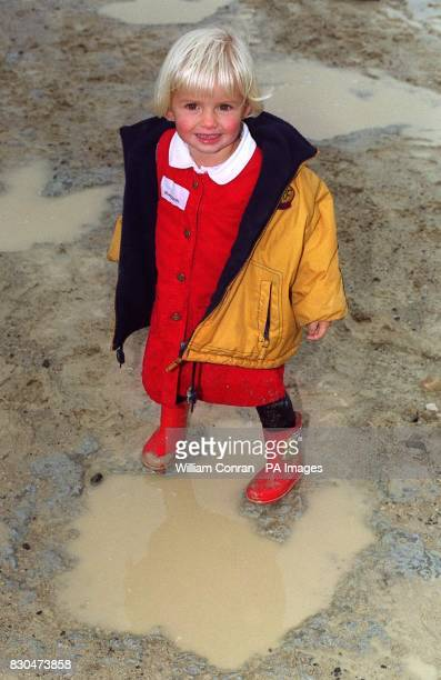 Twoyearold Sacha Pearey from Essex stands in the waterlogged footprint of a dinosaur dating back almost 170 million years