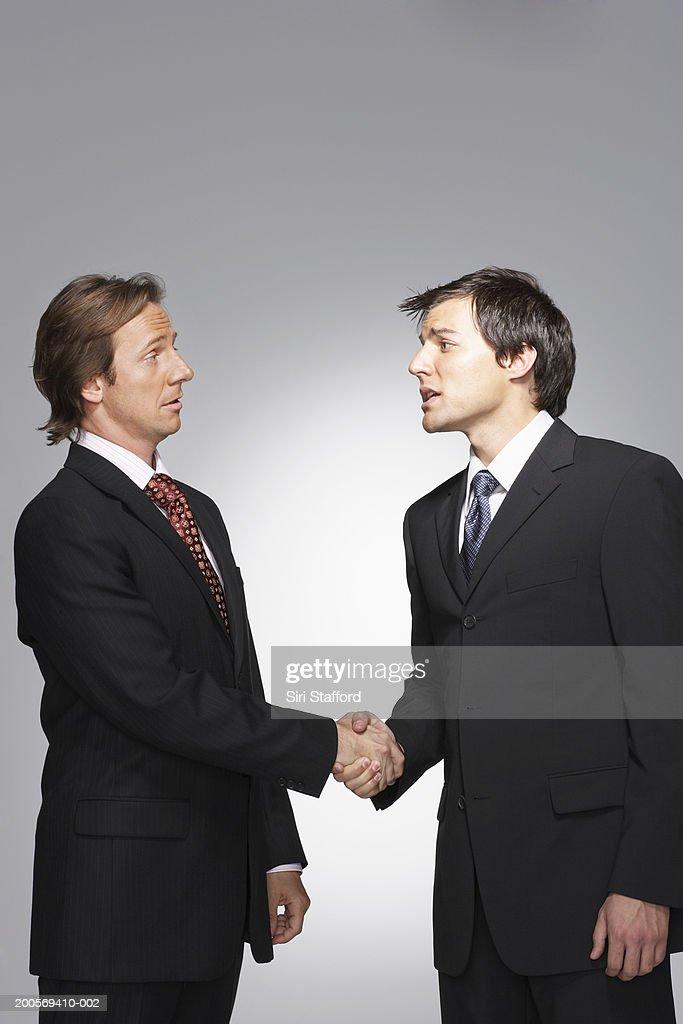 Twp business men shaking hands : Stock Photo