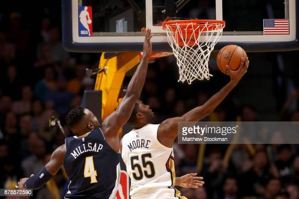 Twuan Moore of the New Orleans Pelicans drives to the basket against Paul Millsap of the Denver Nuggets at the Pepsi Center on November 17 2017 in...
