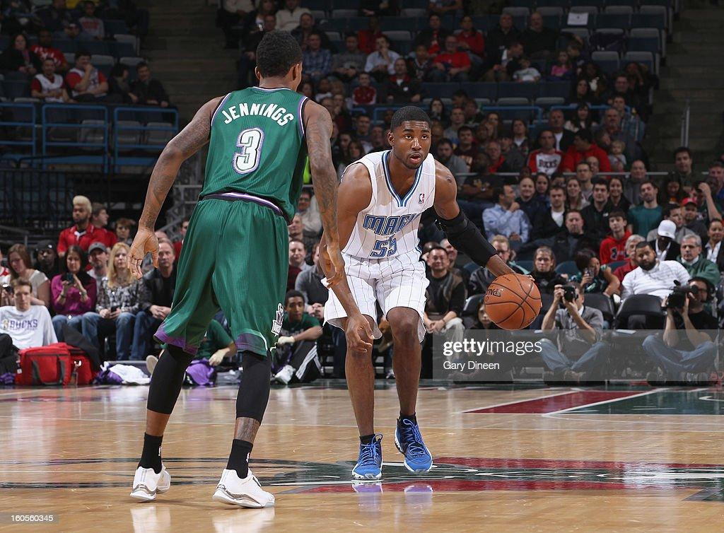E'Twuan Moore #55 of the Orlando Magic dribbles against Brandon Jennings #3 of the Milwaukee Bucks on February 2, 2013 at the BMO Harris Bradley Center in Milwaukee, Wisconsin.