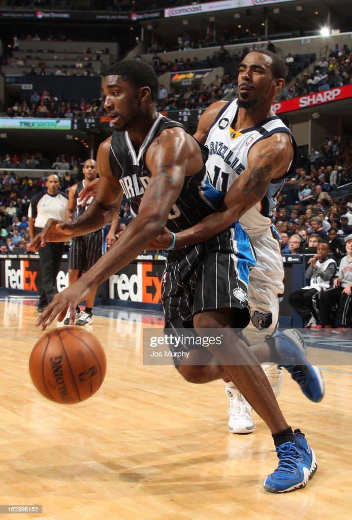 E'Twuan Moore #55 of the Orlando Magic drives against Mike Conley #11 of the Memphis Grizzlies on February 22, 2013 at FedExForum in Memphis, Tennessee.