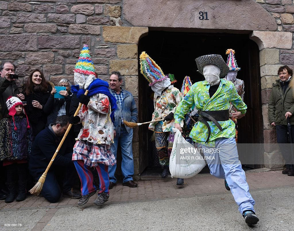'Txatxoak' leave a house during the ancient carnival of Lantz, in the northern Spanish Navarre village of Lantz, on February 9, 2016. / AFP / ANDER GILLENEA