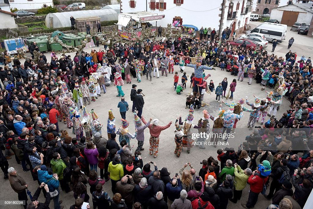 Txatxoaks dance around Miel Otxin (C), a big puppet representing a thief, during the ancient carnival of Lantz in the northern Spanish Navarre village of Lantz, on February 9, 2016. / AFP / ANDER GILLENEA