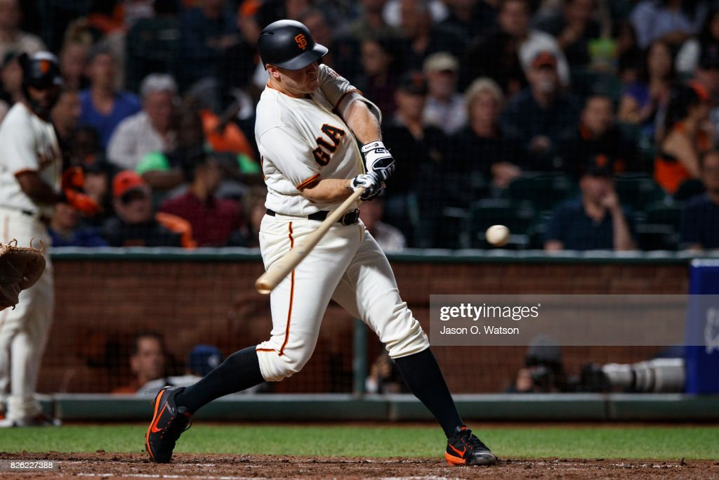 Ty Blach #50 of the San Francisco Giants hits a three run home run against the Oakland Athletics during the fifth inning at AT&T Park on August 3, 2017 in San Francisco, California. The San Francisco Giants defeated the Oakland Athletics 11-2.
