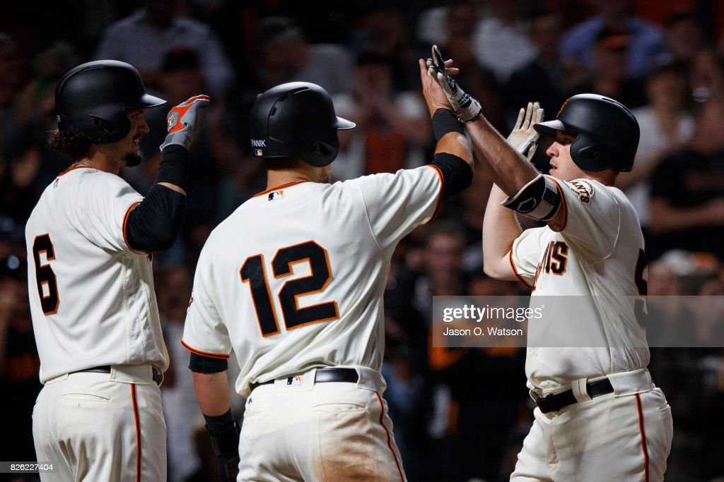 Ty Blach #50 of the San Francisco Giants is congratulated by Jarrett Parker #6 and Joe Panik #12 after hitting a three run home run against the Oakland Athletics during the fifth inning at AT&T Park on August 3, 2017 in San Francisco, California. The San Francisco Giants defeated the Oakland Athletics 11-2.