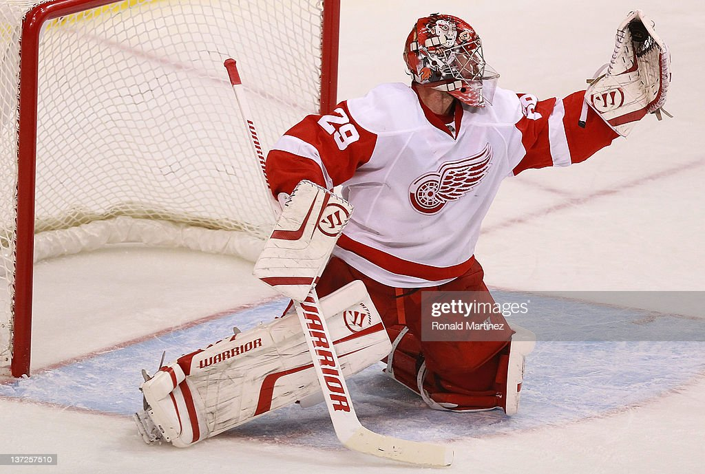 <a gi-track='captionPersonalityLinkClicked' href=/galleries/search?phrase=Ty+Conklin&family=editorial&specificpeople=203338 ng-click='$event.stopPropagation()'>Ty Conklin</a> #29 of the Detroit Red Wings makes a save against the Dallas Stars at American Airlines Center on January 17, 2012 in Dallas, Texas.