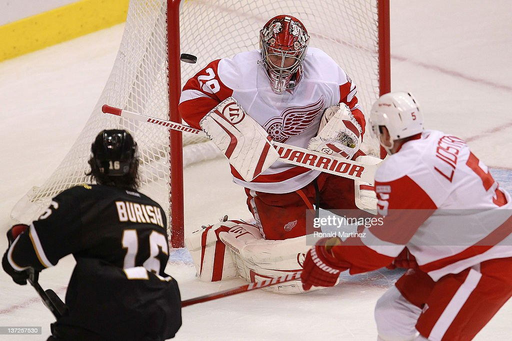 <a gi-track='captionPersonalityLinkClicked' href=/galleries/search?phrase=Ty+Conklin&family=editorial&specificpeople=203338 ng-click='$event.stopPropagation()'>Ty Conklin</a> #29 of the Detroit Red Wings makes a save in front of <a gi-track='captionPersonalityLinkClicked' href=/galleries/search?phrase=Adam+Burish&family=editorial&specificpeople=696936 ng-click='$event.stopPropagation()'>Adam Burish</a> #16 of the Dallas Stars at American Airlines Center on January 17, 2012 in Dallas, Texas.