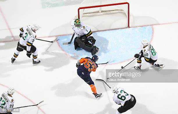 Ty Dellandrea of the Flint Firebirds is stopped by Tyler Parsons and Alex Formenton of the London Knights during an OHL game at Budweiser Gardens on...