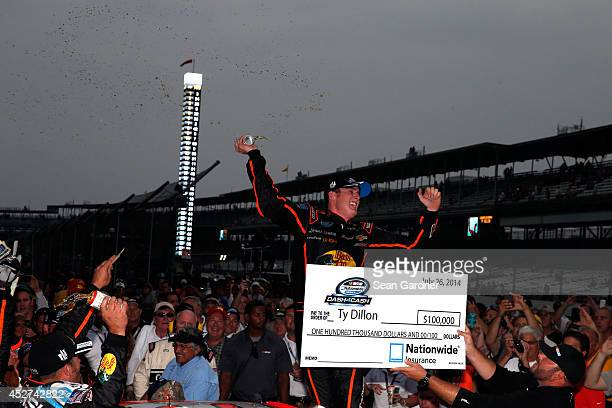 Ty Dillon driver of the Bass Pro Shops Chevrolet celebrates in Victory Lane after winning the NASCAR Nationwide Series Lilly Diabetes 250 at...