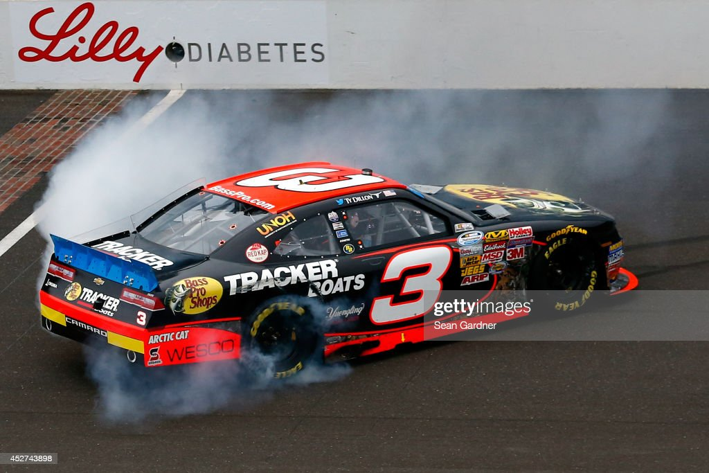 <a gi-track='captionPersonalityLinkClicked' href=/galleries/search?phrase=Ty+Dillon&family=editorial&specificpeople=6312493 ng-click='$event.stopPropagation()'>Ty Dillon</a>, driver of the #3 Bass Pro Shops Chevrolet, celebrates with a burnout after winning the NASCAR Nationwide Series Lilly Diabetes 250 at Indianapolis Motor Speedway on July 26, 2014 in Indianapolis, Indiana.