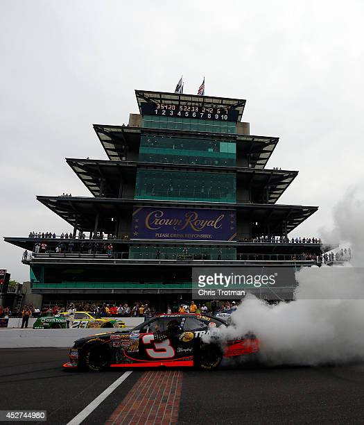 Ty Dillon driver of the Bass Pro Shops Chevrolet celebrates with a burnout after winning the NASCAR Nationwide Series Lilly Diabetes 250 at...