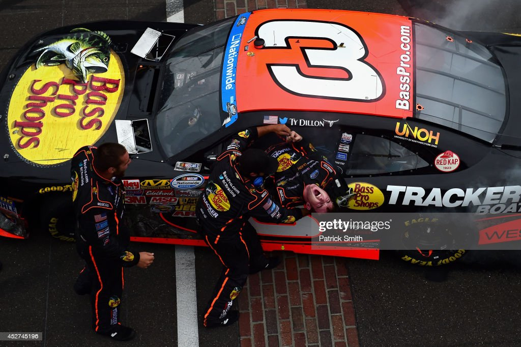 <a gi-track='captionPersonalityLinkClicked' href=/galleries/search?phrase=Ty+Dillon&family=editorial&specificpeople=6312493 ng-click='$event.stopPropagation()'>Ty Dillon</a>, driver of the #3 Bass Pro Shops Chevrolet, celebrates with his team after winning the NASCAR Nationwide Series Lilly Diabetes 250 at Indianapolis Motor Speedway on July 26, 2014 in Indianapolis, Indiana.