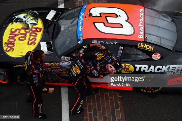 Ty Dillon driver of the Bass Pro Shops Chevrolet celebrates with his team after winning the NASCAR Nationwide Series Lilly Diabetes 250 at...