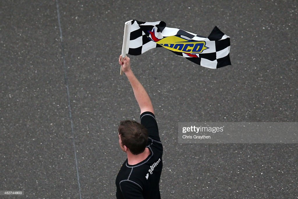 Ty Dillon, driver of the #3 Bass Pro Shops Chevrolet, celebrates with the checkered flag after winning the NASCAR Nationwide Series Lilly Diabetes 250 at Indianapolis Motor Speedway on July 26, 2014 in Indianapolis, Indiana.