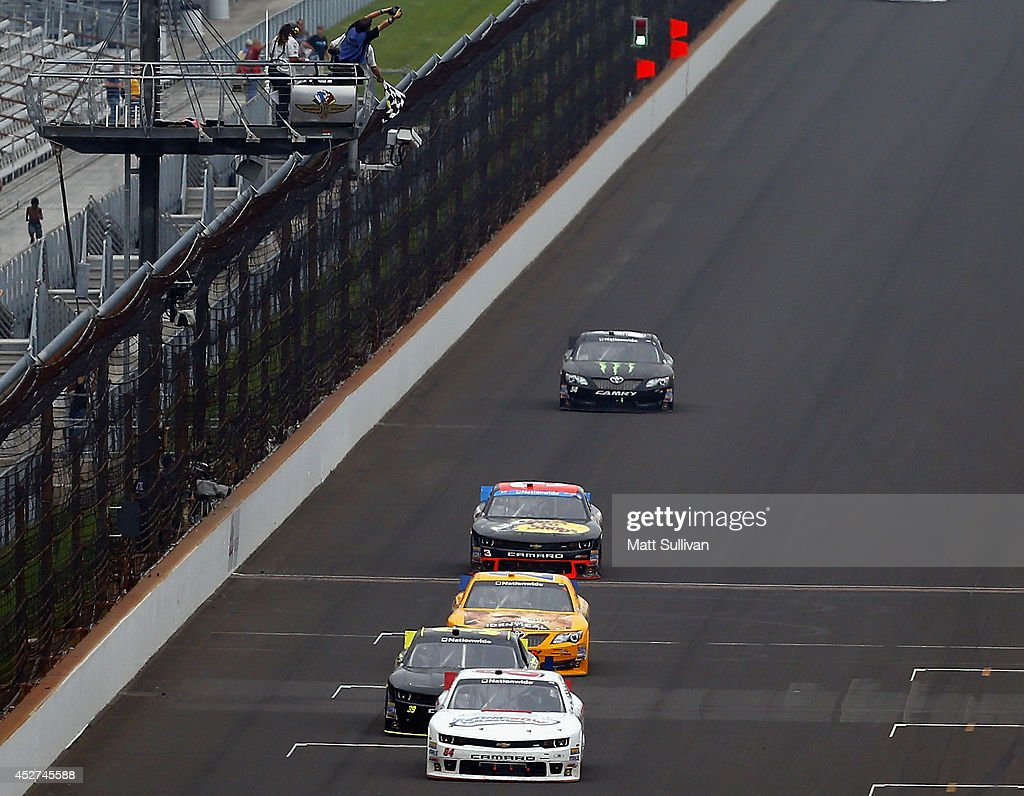 Ty Dillon, driver of the #3 Bass Pro Shops Chevrolet, fourth in line, takes the checkered flag to win the NASCAR Nationwide Series Lilly Diabetes 250 at Indianapolis Motor Speedway on July 26, 2014 in Indianapolis, Indiana.
