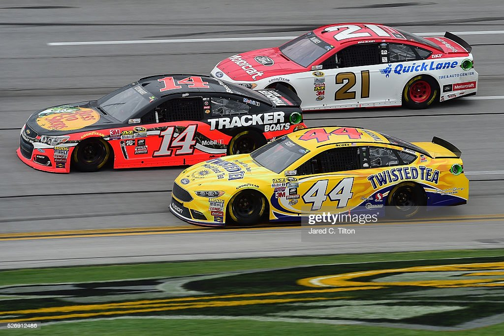 <a gi-track='captionPersonalityLinkClicked' href=/galleries/search?phrase=Ty+Dillon&family=editorial&specificpeople=6312493 ng-click='$event.stopPropagation()'>Ty Dillon</a>, driver of the #14 Bass Pro Shops Chevrolet, leads <a gi-track='captionPersonalityLinkClicked' href=/galleries/search?phrase=Brian+Scott+-+Race+Car+Driver&family=editorial&specificpeople=12790118 ng-click='$event.stopPropagation()'>Brian Scott</a>, driver of the #44 Twisted Tea Ford, and <a gi-track='captionPersonalityLinkClicked' href=/galleries/search?phrase=Ryan+Blaney&family=editorial&specificpeople=8626930 ng-click='$event.stopPropagation()'>Ryan Blaney</a>, driver of the #21 Motorcraft/Quick Lane Tire & Auto Center Ford, during the NASCAR Sprint Cup Series GEICO 500 at Talladega Superspeedway on May 1, 2016 in Talladega, Alabama.