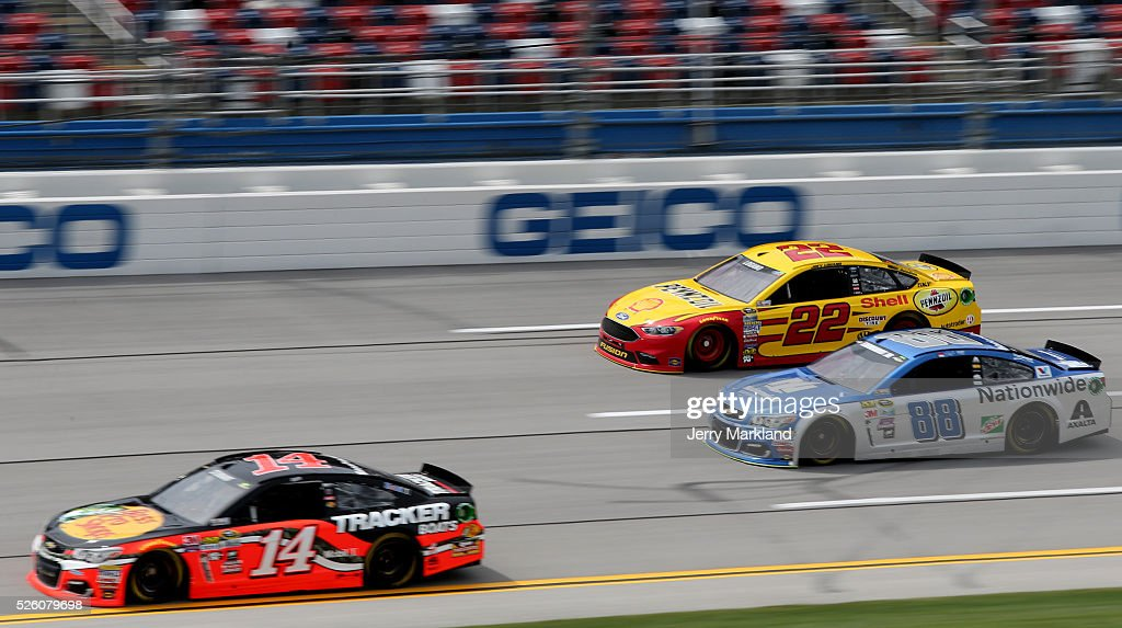 <a gi-track='captionPersonalityLinkClicked' href=/galleries/search?phrase=Ty+Dillon&family=editorial&specificpeople=6312493 ng-click='$event.stopPropagation()'>Ty Dillon</a>, driver of the #14 Bass Pro Shops Chevrolet, leads Dale Earnhardt Jr, driver of the #88 Nationwide Chevrolet, and <a gi-track='captionPersonalityLinkClicked' href=/galleries/search?phrase=Joey+Logano&family=editorial&specificpeople=4510426 ng-click='$event.stopPropagation()'>Joey Logano</a>, driver of the #22 Shell Pennzoil Ford, during practice for the NASCAR Sprint Cup Series GEICO 500 at Talladega Superspeedway on April 29, 2016 in Talladega, Alabama.