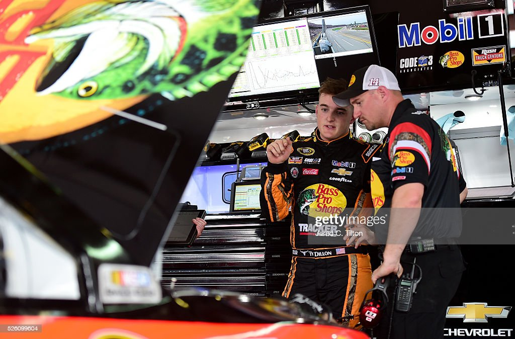 <a gi-track='captionPersonalityLinkClicked' href=/galleries/search?phrase=Ty+Dillon&family=editorial&specificpeople=6312493 ng-click='$event.stopPropagation()'>Ty Dillon</a>, driver of the #14 Bass Pro Shops Chevrolet, speaks to a crew member in the garage area during practice for the NASCAR Sprint Cup Series GEICO 500 at Talladega Superspeedway on April 29, 2016 in Talladega, Alabama.