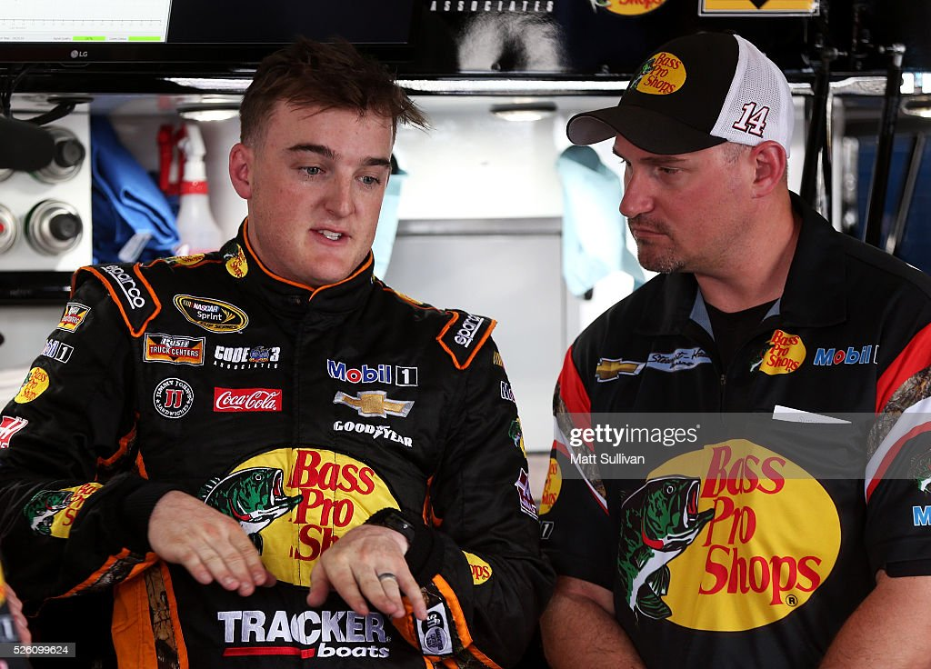 <a gi-track='captionPersonalityLinkClicked' href=/galleries/search?phrase=Ty+Dillon&family=editorial&specificpeople=6312493 ng-click='$event.stopPropagation()'>Ty Dillon</a>, driver of the #14 Bass Pro Shops Chevrolet, speaks to crew chief Mike Bugarewicz in the garage area during practice for the NASCAR Sprint Cup Series GEICO 500 at Talladega Superspeedway on April 29, 2016 in Talladega, Alabama.