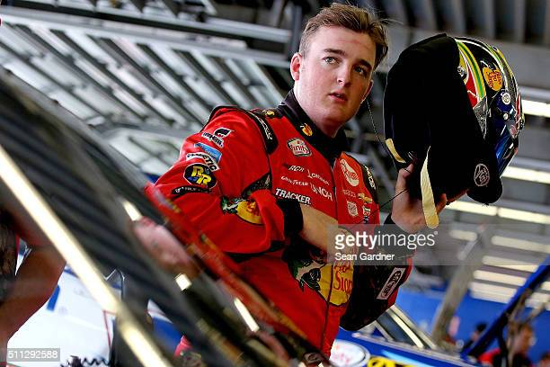Ty Dillon driver of the Bass Pro Shops Chevrolet stands in the garage area during practice for the NASCAR XFINITY Series PowerShares QQQ 300 at...