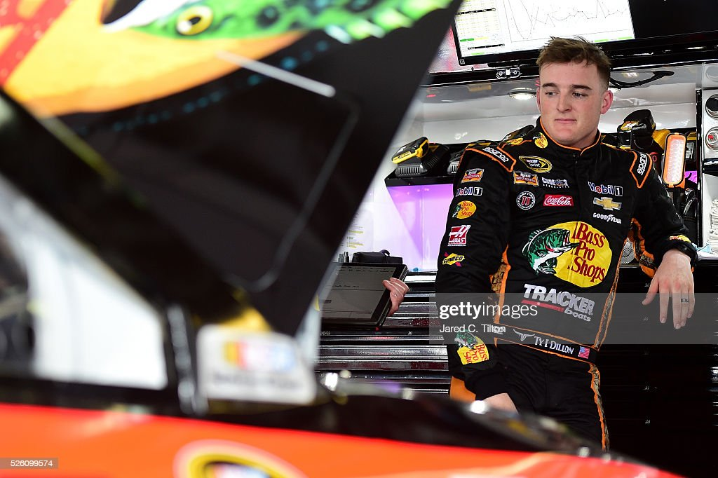 <a gi-track='captionPersonalityLinkClicked' href=/galleries/search?phrase=Ty+Dillon&family=editorial&specificpeople=6312493 ng-click='$event.stopPropagation()'>Ty Dillon</a>, driver of the #14 Bass Pro Shops Chevrolet, stands in the garage area during practice for the NASCAR Sprint Cup Series GEICO 500 at Talladega Superspeedway on April 29, 2016 in Talladega, Alabama.