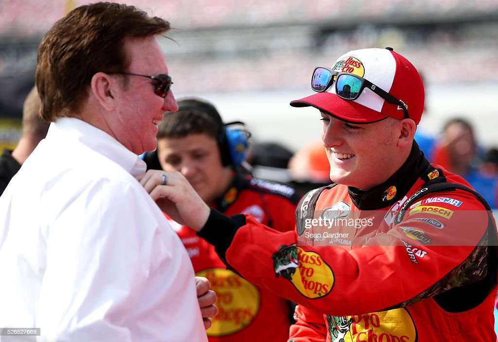 Ty Dillon driver of the Bass Pro Shops Chevrolet stands on the grid with team owner Richard Childress during qualifying for the NASCAR XFINITY Series...