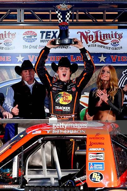 Ty Dillon driver of the Bass Pro Shops / Tracker Boats Chevrolet poses with the trophy in Victory Lane after winning the NASCAR Camping World Truck...
