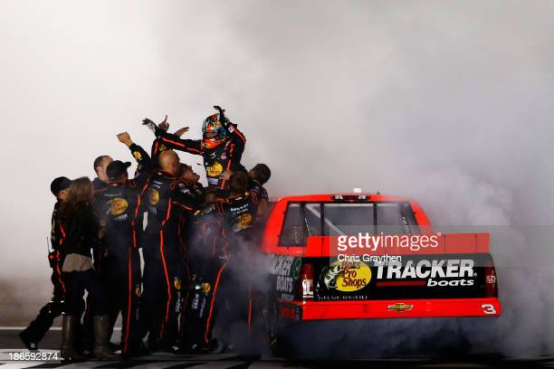Ty Dillon driver of the Bass Pro Shops / Tracker Boats Chevrolet celebrates with his team after winning the NASCAR Camping World Truck Series WinStar...