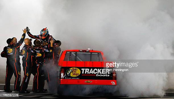 Ty Dillon driver of the Bass Pro Shops / Tracker Boats Chevrolet celebrates with a burnout after winning the NASCAR Camping World Truck Series...