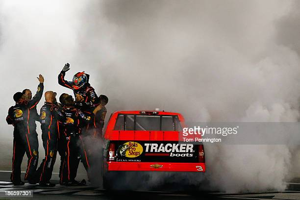 Ty Dillon driver of the Bass Pro Shops / Tracker Boats Chevrolet celebrates with his crew and a burnout after winning the NASCAR Camping World Truck...