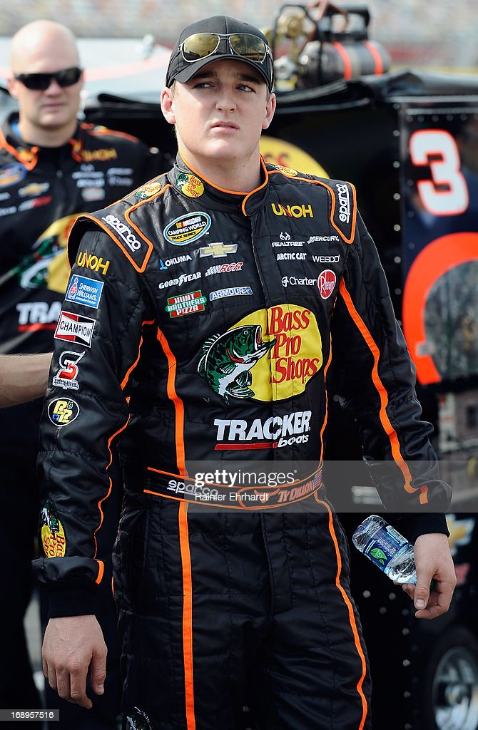 Ty Dillon, driver of the #3 Bass Pro Shops/NWTF Chevrolet, stands on pit road during qualifying for the NASCAR Camping World Truck Series North Carolina Education Lottery 200 at Charlotte Motor Speedway on May 17, 2013 in Concord, North Carolina.