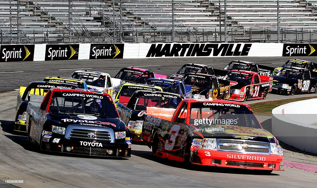 Ty Dillon, driver of the #3 Bass Pro Shops/Tracker Boats Chevrolet, leads Darrell Wallace Jr., driver of the #54 ToyotaCare Toyota, during the NASCAR Camping World Truck Series Kroger 200 at Martinsville Speedway on October 26, 2013 in Martinsville, Virginia.