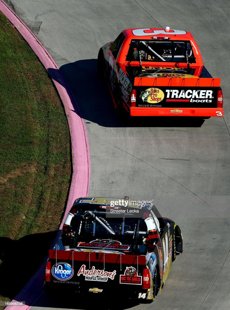 <a gi-track='captionPersonalityLinkClicked' href=/galleries/search?phrase=Ty+Dillon&family=editorial&specificpeople=6312493 ng-click='$event.stopPropagation()'>Ty Dillon</a>, driver of the #3 Bass Pro Shops/Tracker Boats Chevrolet, leads <a gi-track='captionPersonalityLinkClicked' href=/galleries/search?phrase=Kevin+Harvick&family=editorial&specificpeople=209186 ng-click='$event.stopPropagation()'>Kevin Harvick</a>, driver of the #14 Anderson's Maple Syrup/Kroger Chevrolet, during the NASCAR Camping World Truck Series Kroger 200 at Martinsville Speedway on October 26, 2013 in Martinsville, Virginia.