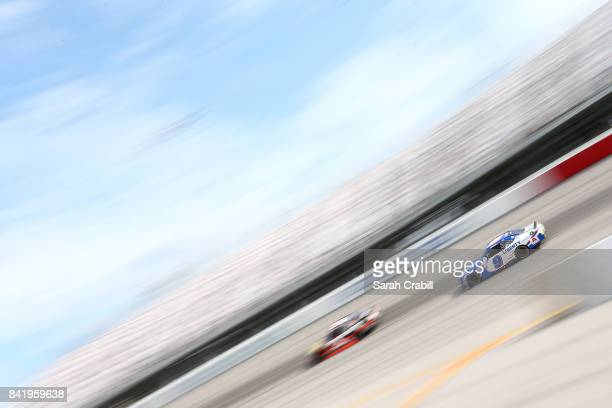 Ty Dillon driver of the Bass Pro Shops/Tracker Boats Chevrolet leads William Byron driver of the Liberty University Chevrolet during the NASCAR...