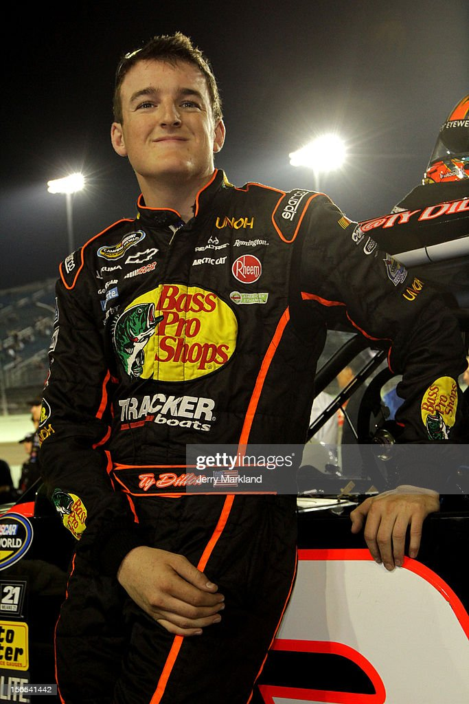 Ty Dillon, driver of the #3 Bass Pro Shops/Tracker Boats Chevrolet, leans against his truck on pit road during the NASCAR Camping World Truck Series Ford EcoBoost 200 at Homestead-Miami Speedway on November 16, 2012 in Homestead, Florida.