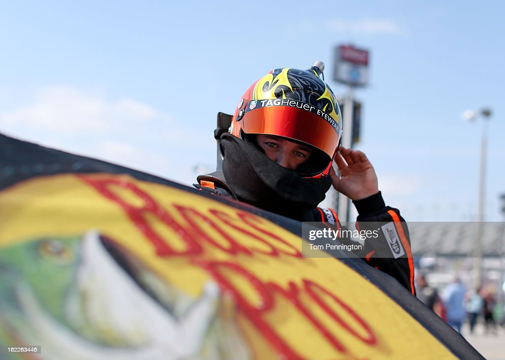 <a gi-track='captionPersonalityLinkClicked' href=/galleries/search?phrase=Ty+Dillon&family=editorial&specificpeople=6312493 ng-click='$event.stopPropagation()'>Ty Dillon</a>, driver of the #3 Bass Pro Shops/Tracker Boats Chevrolet, stands by his car in the garage area during practice for the NASCAR Camping World Truck Series Next Era Energy Resources 250 at Daytona International Speedway on February 21, 2013 in Daytona Beach, Florida.
