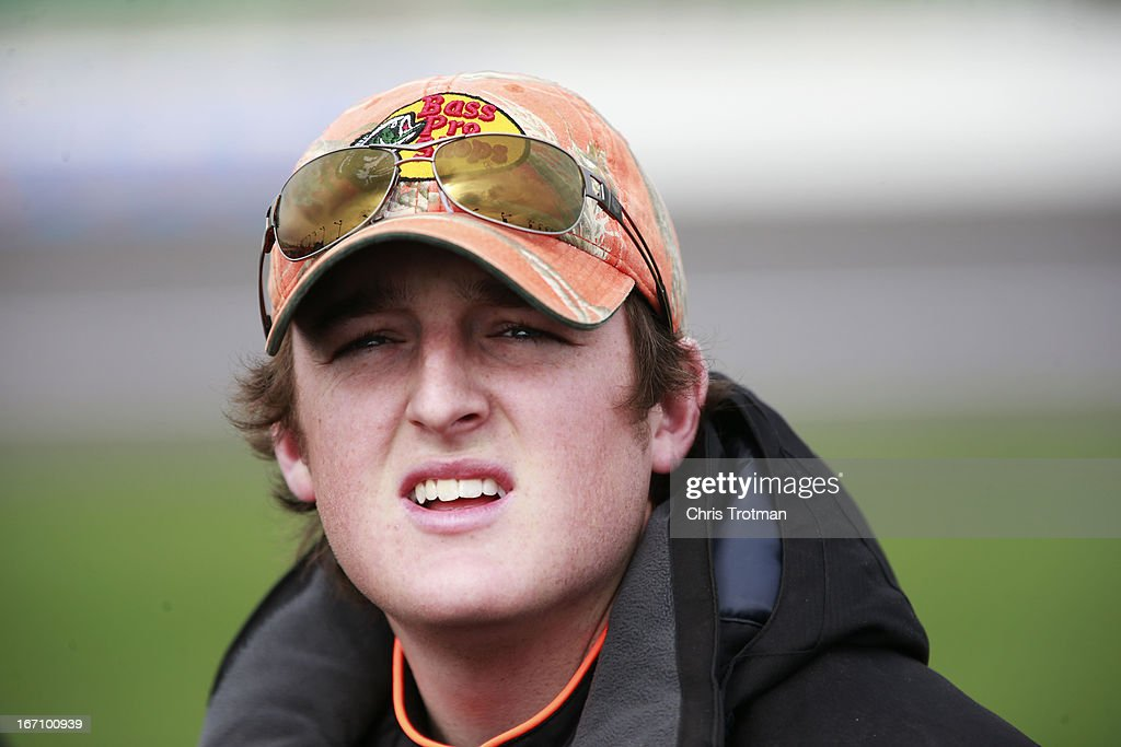 Ty Dillon, driver of the #3 Bass Pro Shops/Tracker Boats Chevrolet, stands on the grid during qualifying for the NASCAR Camping World Truck Series SFP 250 at Kansas Speedway on April 20, 2013 in Kansas City, Kansas.