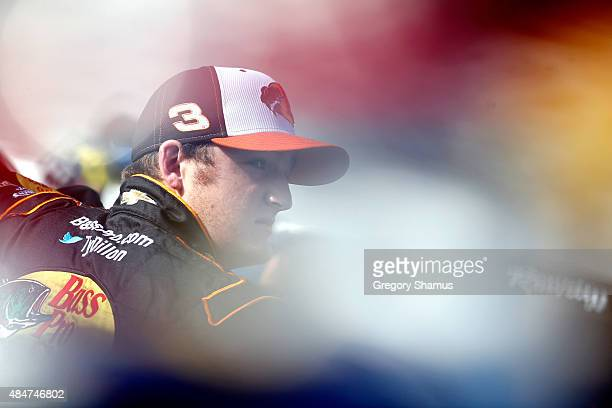 Ty Dillon driver of the Bass Pro Shops/Tracker Boats Chevrolet stands in the garage area during practice for the NASCAR XFINITY Series Food City 300...