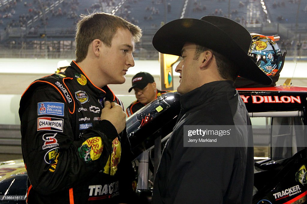 Ty Dillon, driver of the #3 Bass Pro Shops/Tracker Boats Chevrolet, talks with Nationwide driver Austin Dillon and driver of the #3 Bass Pro Shops Chevrolet on pit road during the NASCAR Camping World Truck Series Ford EcoBoost 200 at Homestead-Miami Speedway on November 16, 2012 in Homestead, Florida.