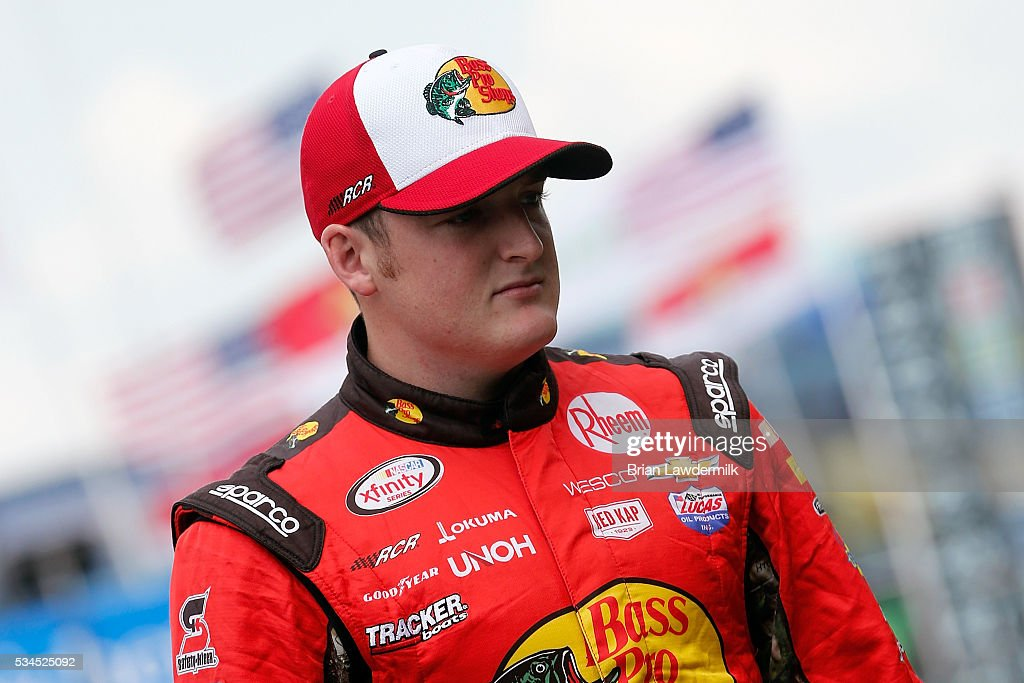 <a gi-track='captionPersonalityLinkClicked' href=/galleries/search?phrase=Ty+Dillon&family=editorial&specificpeople=6312493 ng-click='$event.stopPropagation()'>Ty Dillon</a>, driver of the #3 Bass Pro Shops/Tracker Chevrolet, walks through the garage area during practice for the NASCAR XFINITY Series Hisense 4K TV 300 at Charlotte Motor Speedway on May 27, 2016 in Charlotte, North Carolina.